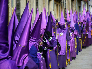 Purple cloaks and hoods (capirotes)